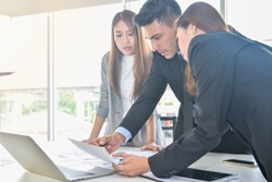 Financial report analysis and reviewing concept :CFO or chief financial officer sees financial summary reports with his secretary team and discusses about future growth and improvements