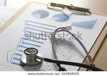 financial report chart and calculator Medical Report and stethoscope #669868048