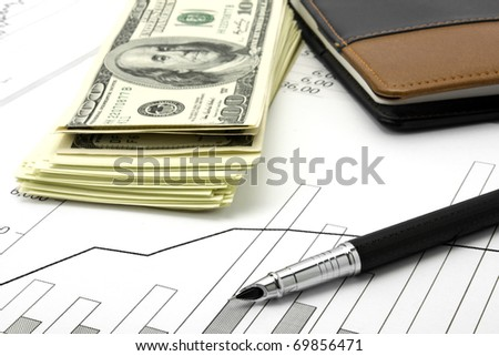 financial report with pen