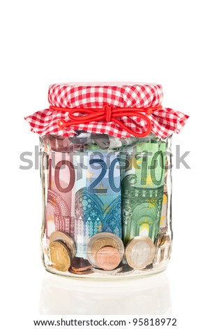 Financial reserves. Money conserved in a glass jar. Shallow deep of focus.