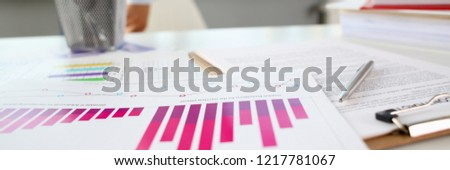 Financial statistics documents ball pen infographics at office table closeup. Internal Revenue Service inspector sum check, investigation, exchange market, earnings, savings, loan and credit concept #1217781067