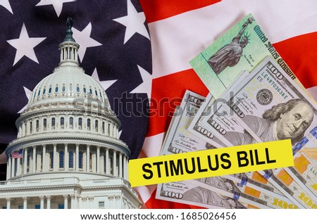 Financial stimulation voronavirus Global pandemic Covid 19 lockdown financial relief checks from government US 100 dollar bills currency on American flag Photo stock ©