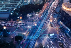 Financial stock chart hologram on top view of road, busy urban traffic highway at night. Junction network of transportation infrastructure. The concept of logistics and transactions.
