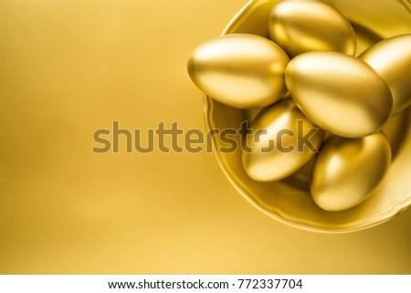 Financial success. Golden Egg in Golden Plate on golden background. #772337704