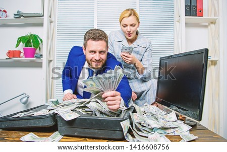 Financial success. Man businessman and woman secretary with pile dollar banknotes. Profit and richness concept. Businessman near cash dollars profit. Huge profit concept. Counting money profit.