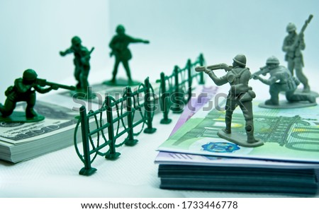 Financial war concept. Currency financial war concept dollar and euro bills . soldiers in currency war