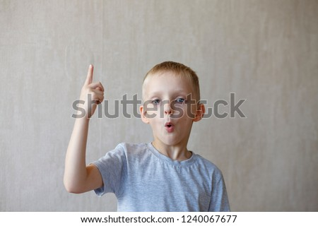 find a solution, emotion boy, A little 7 years old boy showing eureka sign with finding the solution