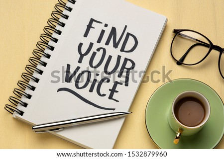 Find your voice text -inspirational handwriting ina sketchbook  with a cup of coffee, communication, brand, personality and identity concept