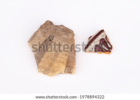Finds of archaeologists. Shards of ancient ceramics. Artifacts from the ancient city. Drawings on ancient ceramics. Fragments of ancient pottery. History of the nomads. Archeology. White background