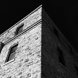 Fine art black and white photo of stone building