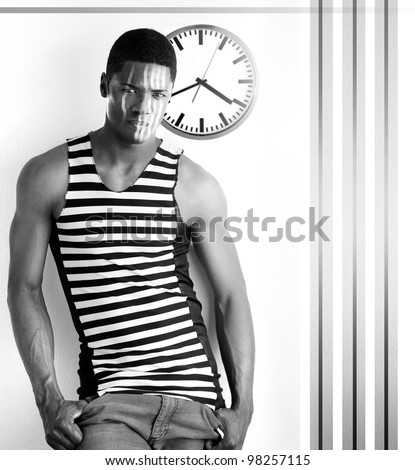 Fine art high contrast black and white photo of a male model with abstract retro clock and stripes against white modern background