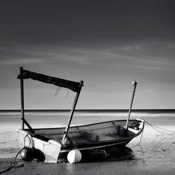 Fine art image in balck and white of Early morning sunrise, boat near the beach, long exposure photography. located at Terengganu, Malaysia.