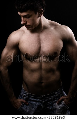 Fine art image of muscular sexy shirtless young man