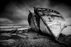 FINE ART OLD DERELICT WOODEN BOATS  ON BEACH  MOODY BLACK AND WHITE  SALEN ISLE OF MULL SCOTLAND