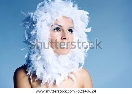 Fine art photo of a beautiful woman - winter queen in fantasy world