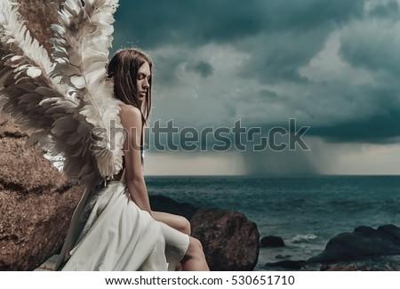 Fine art photo of a woman in white dress as an angel #530651710