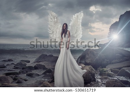 Stock Photo Fine art photo of a woman in white dress as an angel