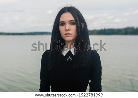 Fine art portrait of a beautiful lady on the sea river on the pier