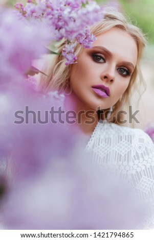 Fine art portrait of a girl in vintage dress in summer time