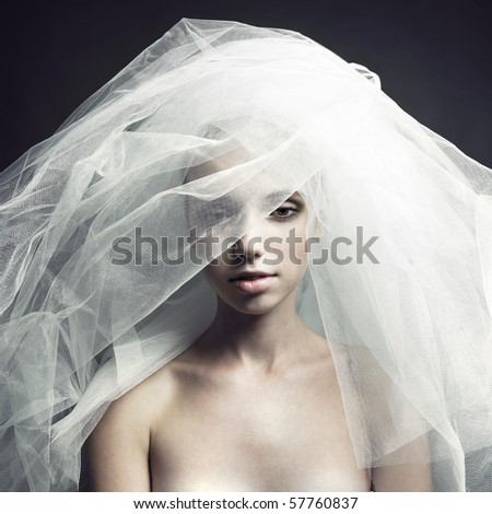 Fine-art portrait of elegant girl in veil