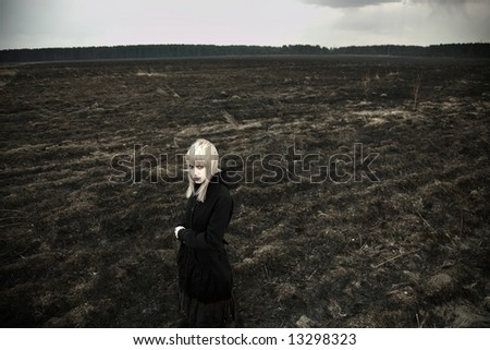Fine art portrait of elegant girl on black field.
