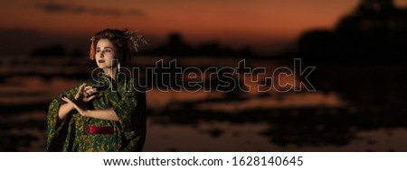 Fine art portrait of european woman in Japanese Geisha style wearing kimono. Panorama