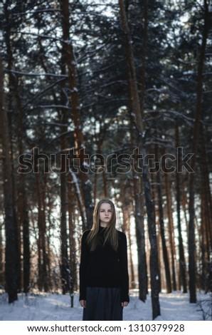Fine Art Portrait of young women in winter landscape