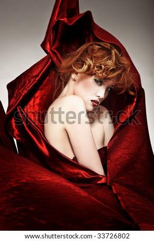Fine art style photo of a beautiful redhead woman