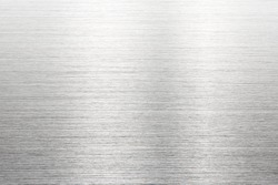 Fine brushed metal with reflection. Photograph of brushed metal, or hair line pattern metal. High resolution Sharp to the corners.