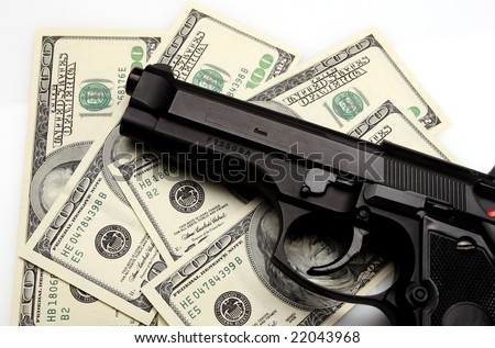 fine close up image of pistol and dollar