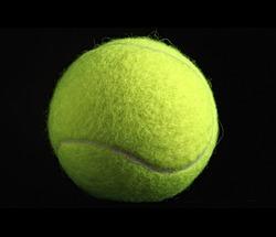 fine closeup image of classic yellow tennis ball