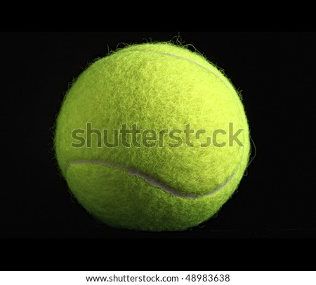 fine closeup image of classic yellow tennis ball