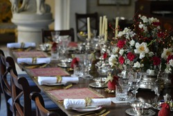 fine decorated dining table. Event. Banquet. Celebration. Wedding. Rich silverware. Luxury