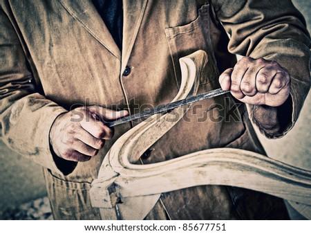 fine detail of caucasian carpenter at work