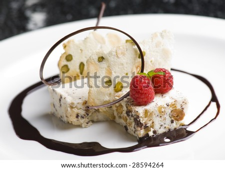 fine dining dessert on a white plate
