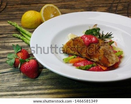 fine dining foods.grille honey glazed salmon with strawberry sauce. healthy food,healthy food with herbs,healthy food concept
