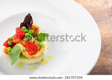 Fine dining, Fried Octopus on potato puree, green peas and fresh strawberries
