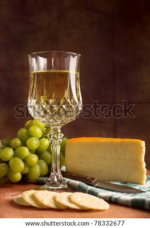 Fine Dining glass of white wine accompanied by cheese, green grapes and crackers #78332677