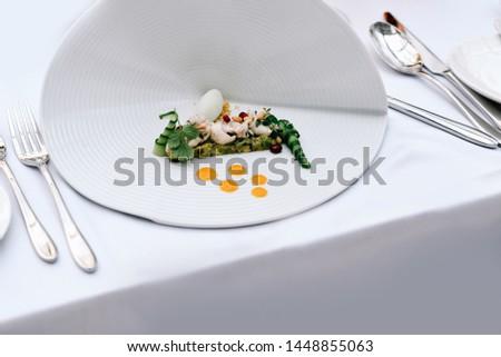 Fine dining meal in a fancy restaurant. Fancy dish #1448855063