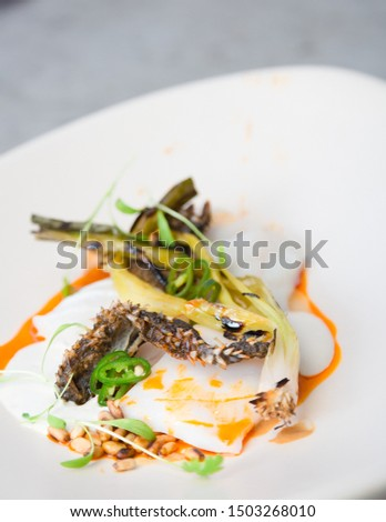 Fine dining plated fish on white plate
