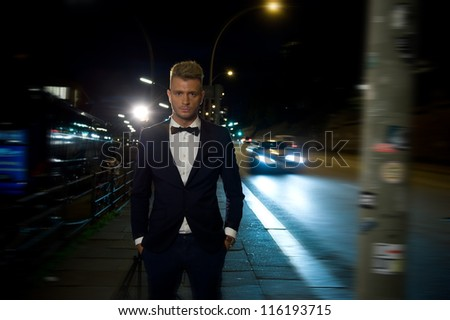 Fine dressed young men standing on the street at night