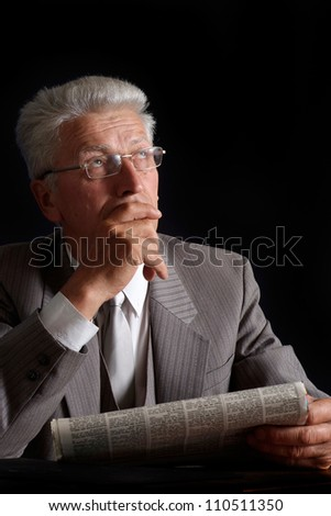Fine elderly man in suit on black background