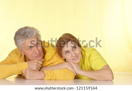 Fine family in yellow t-shirts having a good time together