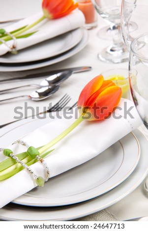 stock photo Fine food and wine spring table settings with fresh tulips