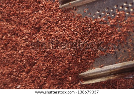 fine grated chocolate on grater , shallow dof