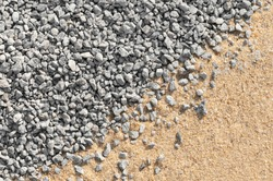 Fine grey gravel and building sand for background or texture - view from above; Construction materials; Fillings; Subsoil for paving