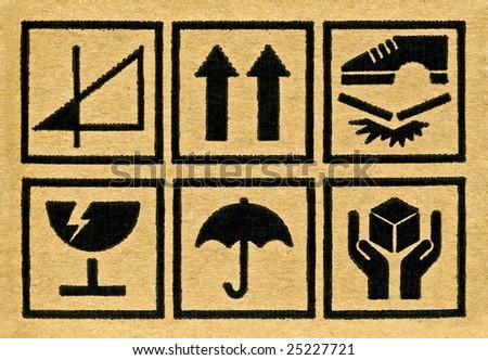 Fine image close-up of grunge black fragile symbol on cardboard