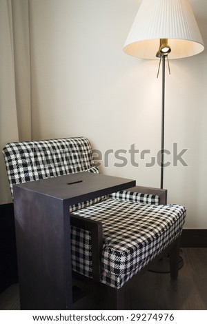 fine image of a chair and lamp in minimalist setting