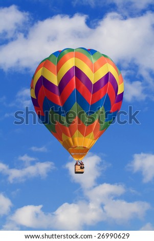 fine image of white clouds and blue sky wit colorful hor air balloon