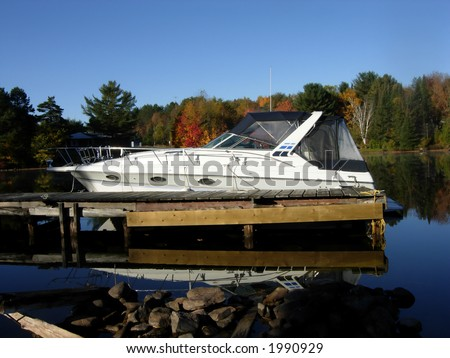 Fine looking boat tied up at a dock in cottage country, Muskoka, Ontario, Canada.